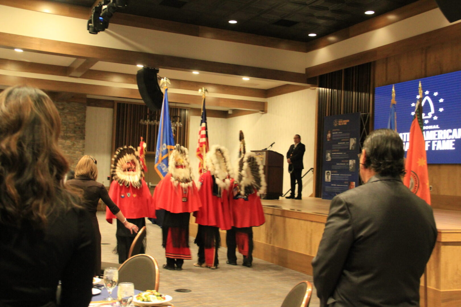Black Leggings Society present the colors at the Native American Hall of fame ceremony